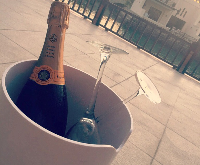 Champagne and glasses in a bucket